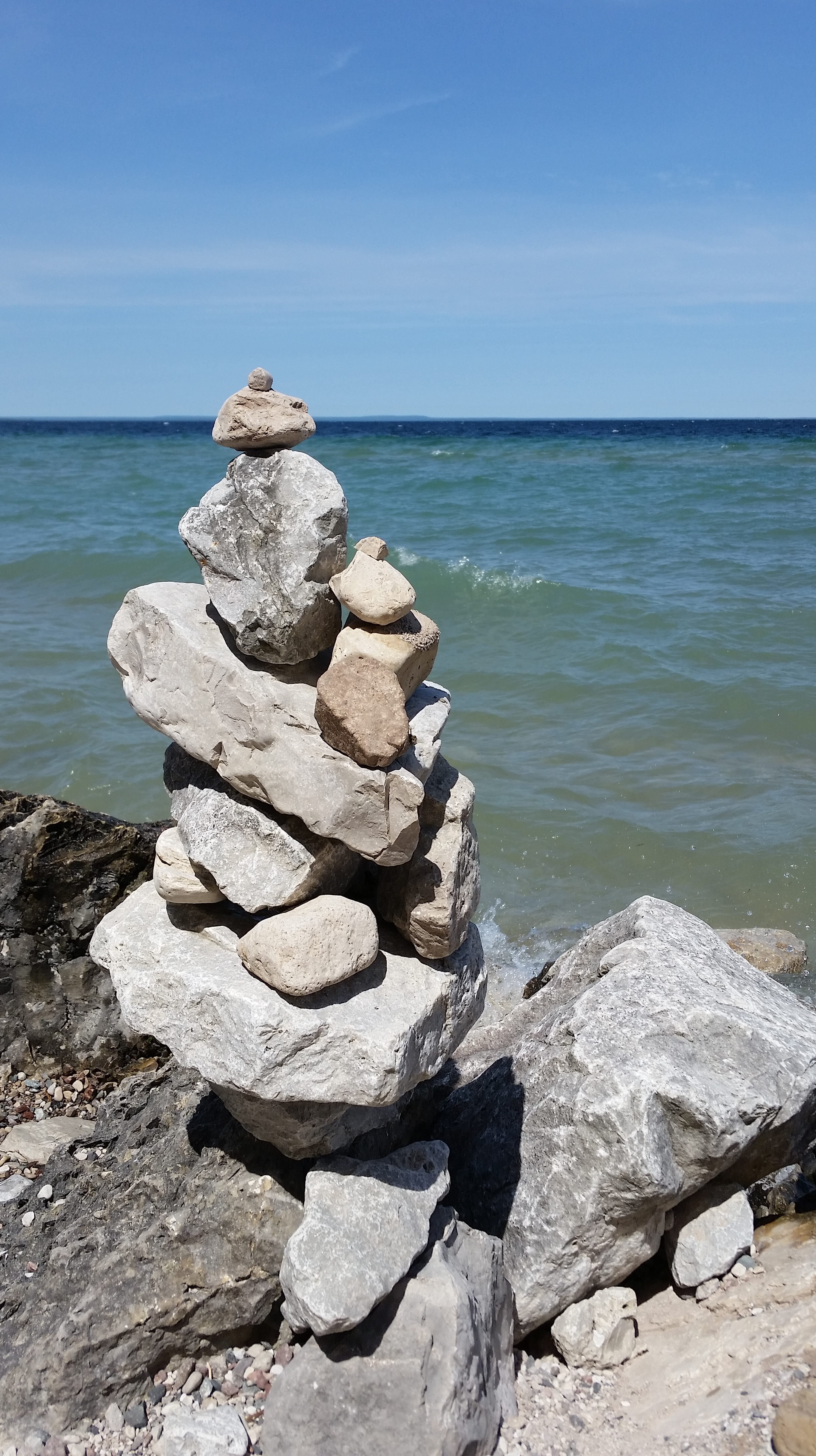 A stack of rocks next to Lake Huron.
