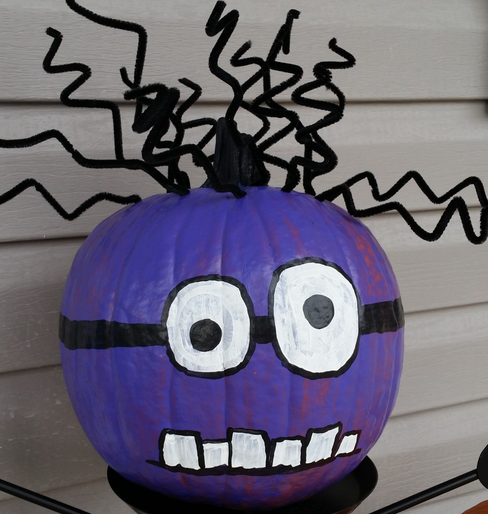 Painted Pumpkin with black hair.