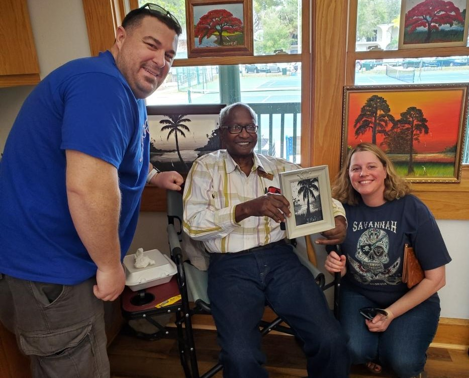 Florida Highwaymen artist Isaac Knight and two other people.