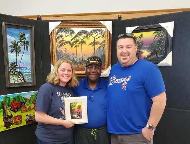 Florida Highwaymen artist Robert Lewis and two other people